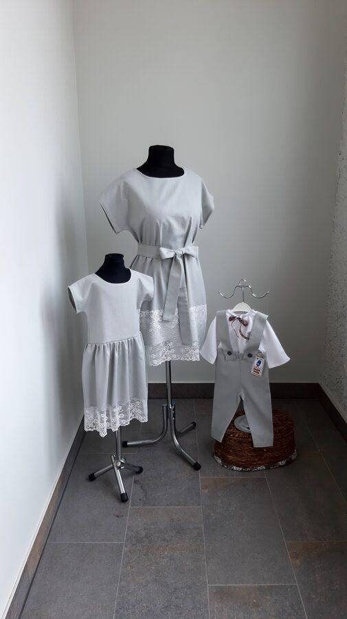 Balts lina krekls , pelēkas lina bikses ar lencēm.
